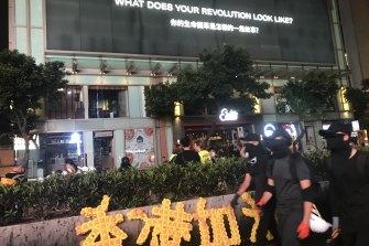 Hong Kong protesters on Nathan Road in Mongkok on Saturday night.