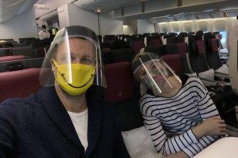 Tom McNamara with his fiancee on their flight home.