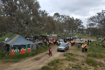 Police officers and roads workers move into the Djab Wurrung site on the Western Highway on Tuesday morning.