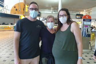 Kimberley Jones (centre) was reunited with her son Tyler Jones and daughter-in-law-to-be Maddie Blue at Brisbane Airport.