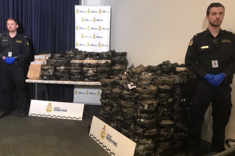 Authorities show off the alleged ephedrine seizure.