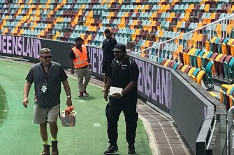 Ground staff at the Gabba check a new video cabling system allowing extra fence signage flexibility for advertisers.