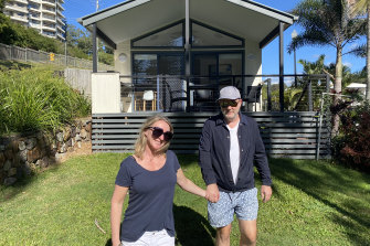 Kate Halfpenny and her husband Chris outside their rented cabin in Burleigh Heads.