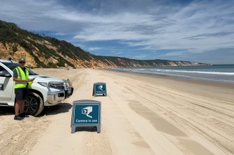 Principal ranger Emma Barraclough operates automatic number plate recognition cameras on Cooloola National Park's Rainbow Beach. A similar service is soon to begin on K'Gari, (Fraser Island) to track visitors.