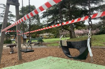 Tape blocks off access to swings at Basterfield Park in Hampton Easton Tuesday.