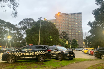 Police outside the public housing towers on Racecourse Road, Flemington.