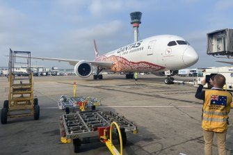 A Qantas flight carrying the first 450,000 doses of the 4 million Pfizer vaccines the UK has agreed to send to Australia sitting on the tarmac at Heathrow Airport on Saturday.