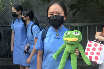 Miss Lo and fellow students in Hong Kong wait for Carrie Lam to arrive at the televised dialogue.