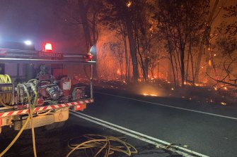 Fire crews battle a bushfire threatening homes near Batemans Bay.
