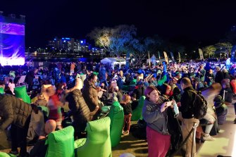 A crowd at South Bank, Brisbane, await the decision of the International Olympic Committee