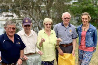 Maree Cadman, far right, and other locals cleaning up the Moruya River on Clean Up Australia Day in 2019.