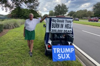 Ed McGinty has become notorious in The Villages for his anti-Trump golf cart signs.