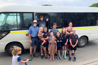 Roy Moriarty, far left, with kids on his last day on Thursday driving the school bus from Kennett River to Lorne on the Great Ocean Road.
