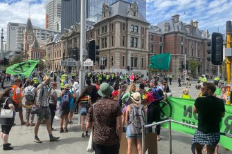 """Police have moved in on Extinction Rebellion protestors who held a """"die-in"""" on St George's Terrace."""