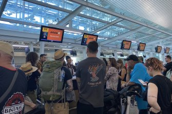 People queue at Denpasar Airport in Bali to board Jetstar flights bound for Australia.