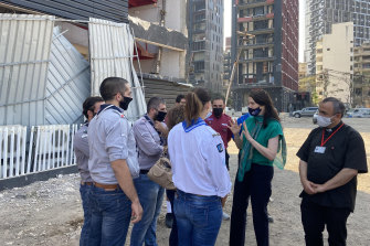 Australian ambassador to Lebanon Rebekah Grindlay briefs volunteers near the site of the massive explosion that rocked Beirut in August.