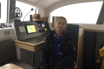 Greta Thunberg sits on a catamaran docked in Hampton on Tuesday.