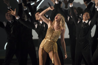 Taylor Swift, winner of the artist of the decade award, performs a medley at the American Music Awards on Sunday (Monday AEST).