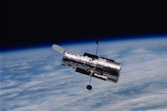 The Hubble Space Telescope in orbit above Earth.