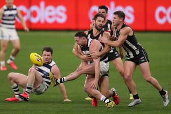 Geelong's Jack Steven manages to get boot to ball.