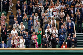 Spectators in the royal box stand for Oxford Professor Sarah Gilbert (seated in red, bottom right), one of the people behind the AstraZeneca COVID-19 vaccine ahead of the opening match on day 1 of The Championships - Wimbledon 2021.