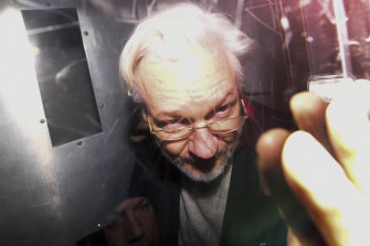Julian Assange leaves in a prison van after appearing at Westminster Magistrates' Court.