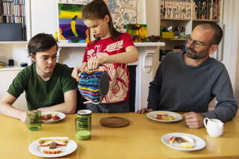 Artist and academic Stefan Lie having afternoon tea, during lockdown with children Rolf and Tino at their Bondi Junction home.