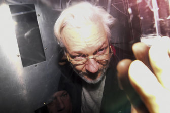 Julian Assange leaves in a prison van after appearing in a London court in January.