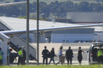 Passengers, including one believed to be Dr Moore-Gilbert, leave a government jet at Canberra Airport in November 2020.