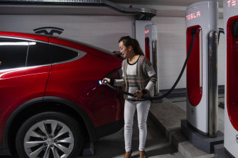 Vicky Wang charges her electric car at a Tesla station in the Broadway shopping centre in inner Sydney.