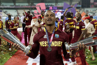 Marlon Samuels celebrates helping the West Indies retain their World T20 crown, four years after a career highlight innings in the 2012 final.