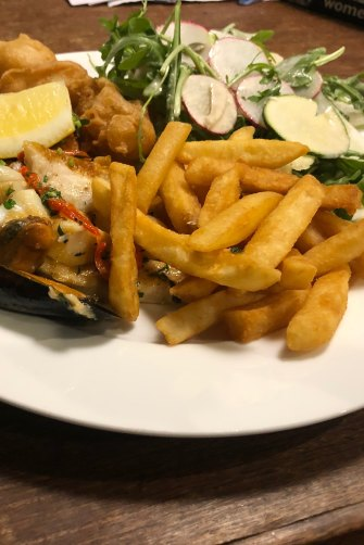 Seafood hot platter from Fich: a mixture of grilled and battered fish, mussels, squid, calamari, chips and salad.