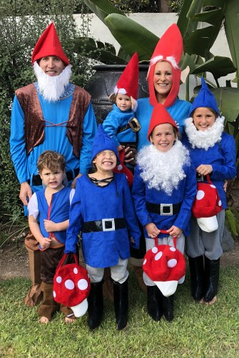 Isaacs with her husband, Rowan, and five of their six children, dressed for Halloween.