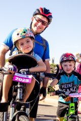 Families having fun at the Big Canberra Bike Ride.