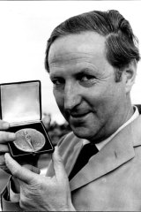 William McBride pictured at Sydney Airport holding the medal presented by the Institute De La Vie in Paris.
