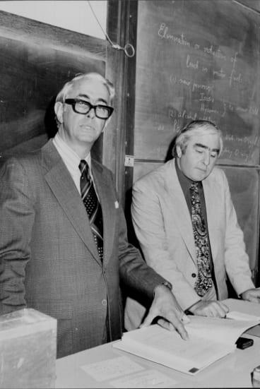 Professor Lloyd Smythe (left) and Dr Ronald Freeman discussing their report on the lead burden on Sydney school children.