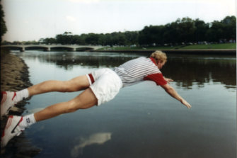 Jim Courier takes a victory dip in the Yarra after winning the Australian Open in 1993.