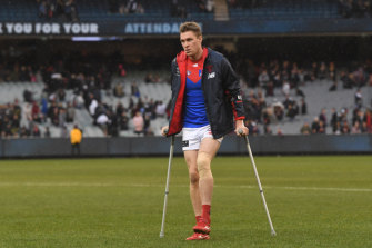 Tom McDonald on crutches on Sunday.