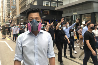 Richard, 29, an engineer, was among the thousands of ordinary office workers to marchthrough central Hong Kong on Friday to protest against a government move to invoke emergency powers banning face masks.