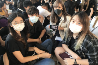 Students gather outside West Kowloon Magistrates Court as 100 protesters face charges.