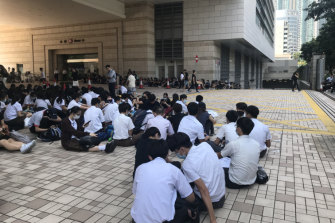 Students boycott classes to sit outside West Kowloon Magistrates Court.