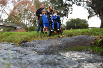 'The creek is dead': Yarraville resident  Claire Halford at Stony Creek with partner Hayden Davies and children Owen, 11, front right, and Ned, 9.