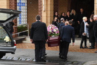 Coffin bearers carry Courtney Herron's coffin into the the St Dimitrios Greek Orthodox Church