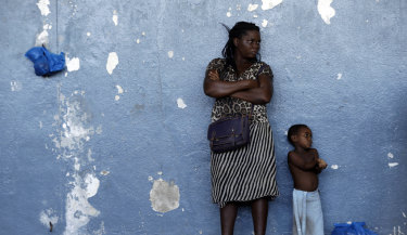 A woman and her child outside a displacement centre in Beira, Mozambique,