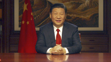 Chinese President Xi Jinping delivers a New Year speech broadcast on state television in Beijing.