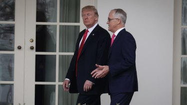 Donald Trump and Malcolm Turnbull walk along the colonnade for their meeting in the Oval Office.