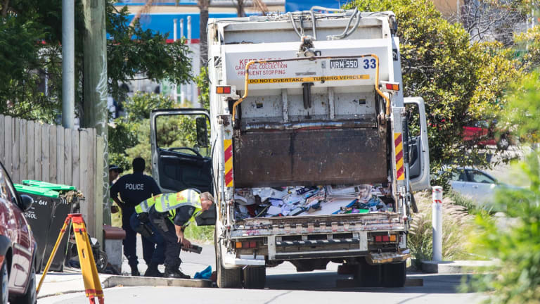 Police inspecting a garbage truck that was involved in the death of a woman on Moonramba Road, Dee Why, on 8 February 2018.