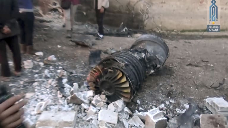 A photo supplied by the media arm of al-Qaida's branch in Syria shows part of a Russian plane that was shot down by rebel fighters over northwest Idlib province in Syria