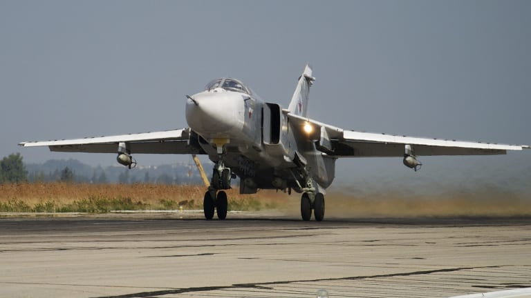 A Russian Su-24 takes off on a combat mission at Hemeimeem airbase in Syria in October.