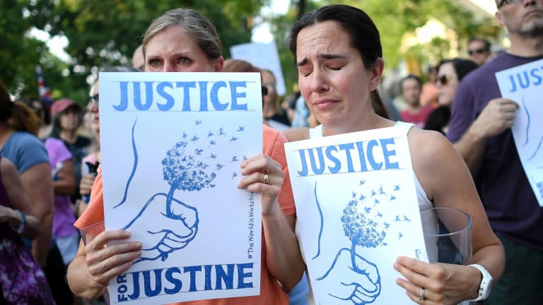 Betsy Custis, right, and others attend a march in honour of Justine Damond at Beard's Plaisance Park in Minneapolis.
